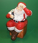 "This wonderful Coca Cola ""Santa"" Cookie Jar was produced in 2002 by Sakura. It stands 13"" tall and is a good solid, heavy jar weighing just over 4 lbs. It is ceramic and is in excellent..."