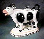 "Click here to enlarge image and see more about item CR095: 5 1/4"" Cow Creamer with Lid"