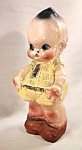 "Click here to enlarge image and see more about item CV016: 12"" Chalk Kewpie Doll Bank"