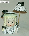 Click here to enlarge image and see more about item HV049: Little Umbrella Girl Head Vase