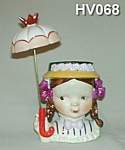 Click here to enlarge image and see more about item HV068: Little Umbrella Girl Head Vase