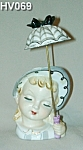 Click here to enlarge image and see more about item HV069: Little Umbrella Girl Head Vase