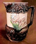 "Click here to enlarge image and see more about item MJ085: 8 1/2"" Majolica Floral Pitcher"