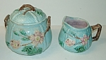 Click here to enlarge image and see more about item MJ289: Majolica Sugar w/Lid and Creamer