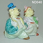 "Click here to enlarge image and see more about item ND040: Pig ""Bride and Groom"" S&P Shaker Nodders"