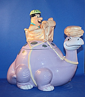 FRED FLINTSTONE ON DINOSAUR COOKIE JAR. (Image1)