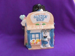 Click here to enlarge image and see more about item 2006: TWEETY & SLYVESTER GARDEN SHOP COOKIE JAR