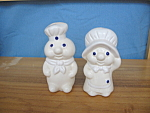 Click here to enlarge image and see more about item 703: DOUGHBOY & GIRL SALT & PEPPER SET