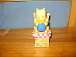 Click here to enlarge image and see more about item DS1010: POOH SITTING ON CHAIR SALT & PEPPER
