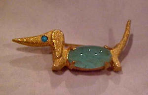 Cadoro Dog pin w/grn glass belly (Image1)