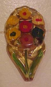 Reversed carved applejuice bakelite dress cli (Image1)