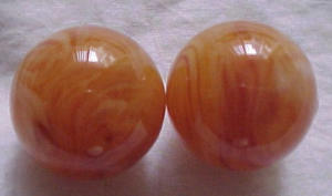 Plastic earrings tan with swirls (Image1)