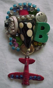 Collage pin with dangling airplane (Image1)