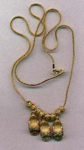 "Goldtone 24"" chain with 3 pair of Mary Jane rhinestone shoes and goldtone spacers in between the shoes.  One shoe is topaz rhine (Image1)"