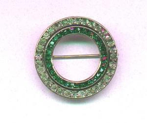 Art deco circular pin with clear and green rhinestones (Image1)