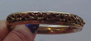 Gold filled bangle w/bows and swirls (Image1)
