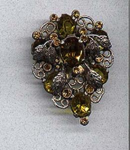 Czechoslovakian dress clip w/topaz stones (Image1)