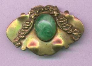 Brass sash ornament with green glass cabachon. (Image1)