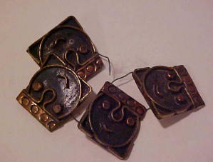 4 copper buttons man's head (Image1)