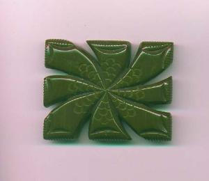 Heavily carved green bakelite brooch (Image1)