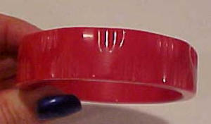Red bakelite bangle with carvings (Image1)