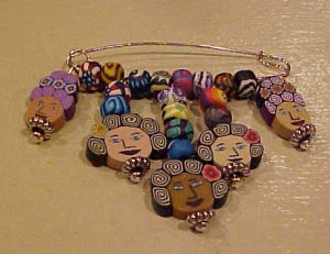 Pin with faces made of fimo clay (Image1)