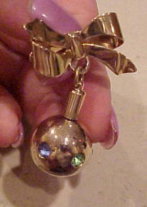 Perfume bottle on bow pin (Image1)