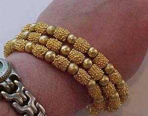 Trifari triple strand gold bead bracelet (Image1)
