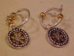 Silvertone pierced hoop earrings. (Image1)