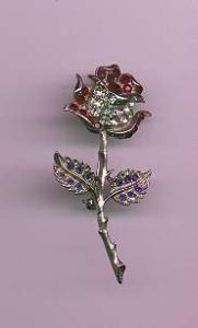 Silvertone metal flower pin with red, clear and blue rhinestones (Image1)