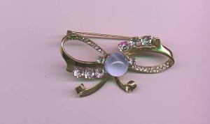 Mazer sterling retro bow pin with blue glass cabachon and clear rhinestones (Image1)
