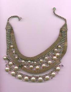 1950's festoon style necklace with aurora borealis rhinestones and faux pearls. (Image1)