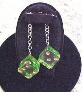 Black bakelite pin with dangling dice (Image1)