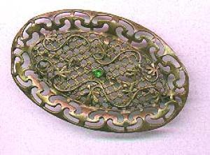 Art Nouveau sash pin with green rhinestone (Image1)