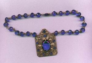 Czechoslovakian blue faceted glass bead necklace with large brass pendant with blue rhinestones (Image1)