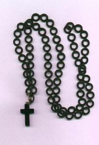 Black bakelite cross on cord (Image1)