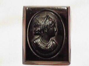 FABULOUS black bakelite cameo brooch. (Image1)