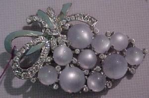 Grape design dress clip with rhinestones and milky cabachons. (Image1)
