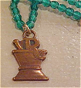 Green Bead necklace with druggist charm (Image1)