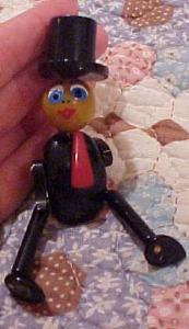 Bakelite man pin with moveable parts (Image1)