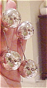 Silvertone dangling earrings with stars (Image1)
