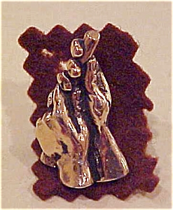 Hands holding stick pin (Image1)