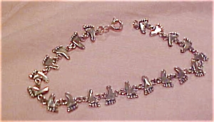 Sterling bracelet with feet (Image1)