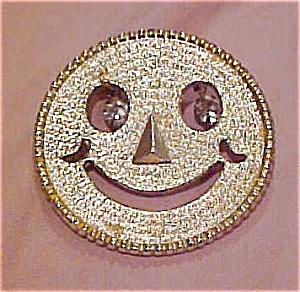 Smiley face pin with rhinestone eyes (Image1)