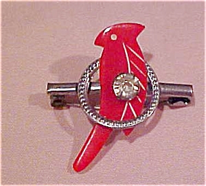 Red plastic bird on silvertone pin (Image1)