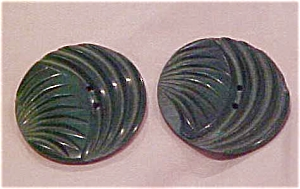 2 green carved plastic buttons (Image1)