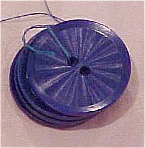 4 blue plastic buttons (Image1)