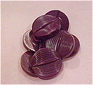 7 brown plastic buttons (Image1)