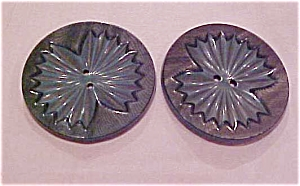 2 green carved two tone plastic buttons (Image1)