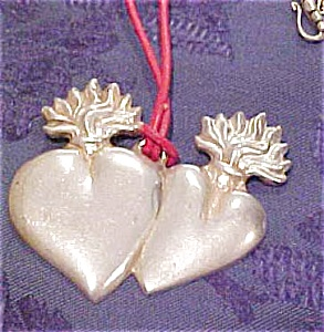 Sacred heart pendant on neck cord (Image1)